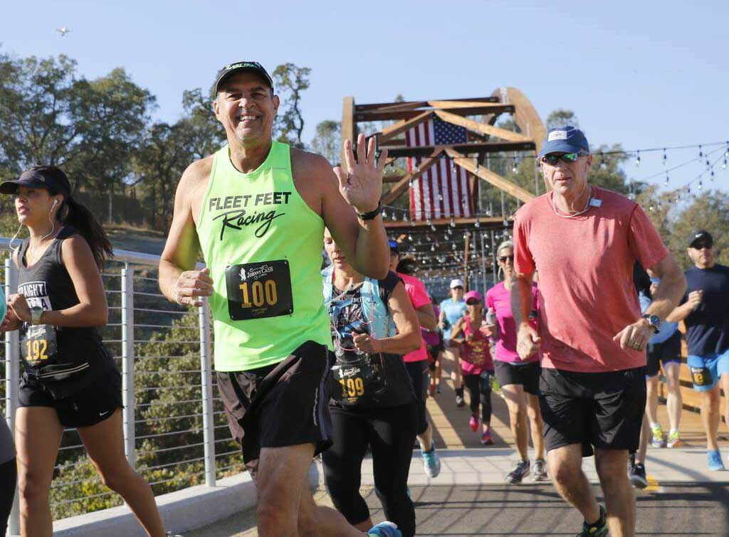 Race participants run over the newly constructed Robbers' Ravine Bridge